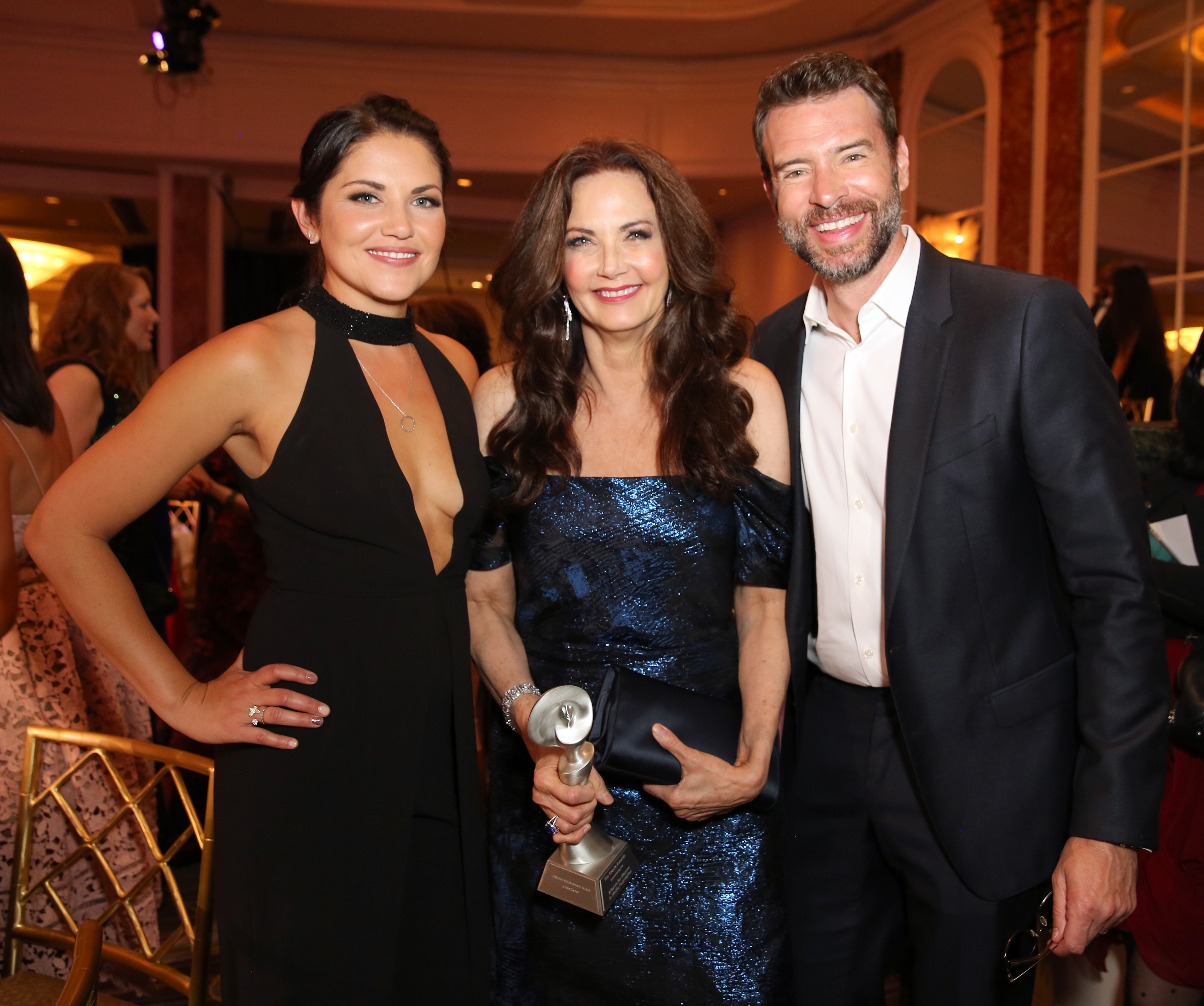 """""""BEVERLY HILLS, CA - MAY 24: (L-R) Actress Marika Dominczyk, Honoree Lynda Carter, with Lifetime Achievement Award, and actor Scott Foley attend the 41st Annual Gracie Awards at Regent Beverly Wilshire Hotel on May 24, 2016 in Beverly Hills, California.  (Photo by Rachel Murray/Getty Images for Alliance for Women in Media )"""""""